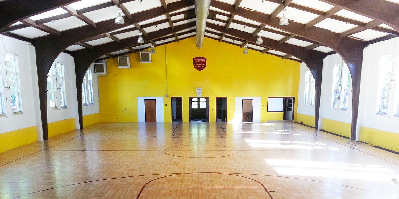 Clean and bright school gymnasium.